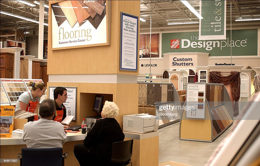 Customers get assistance in the flooring department at the n ...