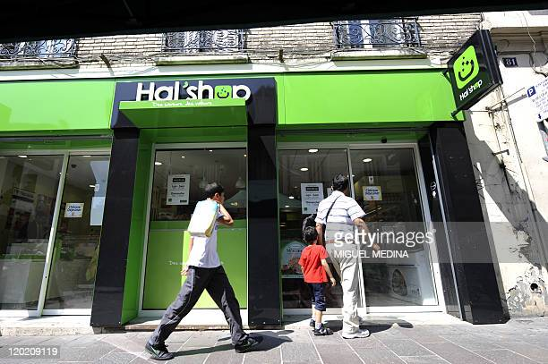 Customers get in a 100% halal food shop the Hal'Shop on August 1st in Nanterre a western suburb of Paris as the Muslim fasting month of Ramadan...