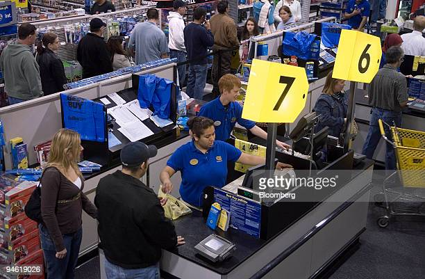Customers go through the checkout lines at the Best Buy store in Corpus Christi Texas on Sunday December 24 2006 US retail sales rose 23 percent...