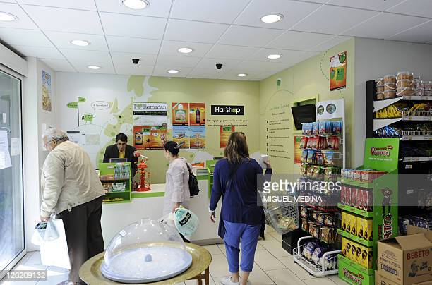 Customers go to the checkout in a 100% halal food shop the Hal'Shop on August 1st in Nanterre a western suburb of Paris as the Muslim fasting month...