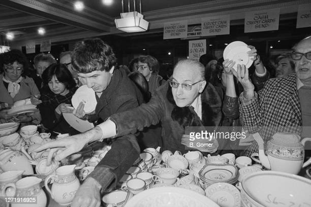 Customers grabbing for china at the Harrods sale in London 4th January 1985