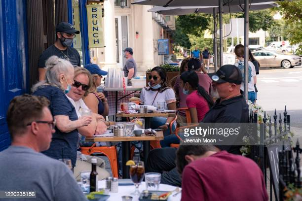 Customers have a lunch outside a restaurant as the city reopens from the coronavirus lockdown on June 15 2020 in Hoboken New Jersey The state has...