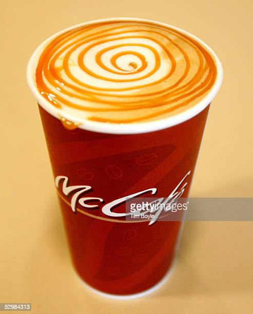 A customer's Hazelnut Caramel Latte sits on a counter at a new McCafe inside a newly constructed McDonald's restaurant May 26 2005 in Oak Brook...