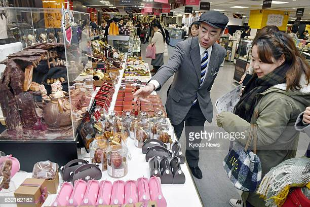 Customers hunt out chocolates at a special booth at Kintetsu Department Store in Osaka on Jan 20 as the season for selling Valentine's Day chocolate...