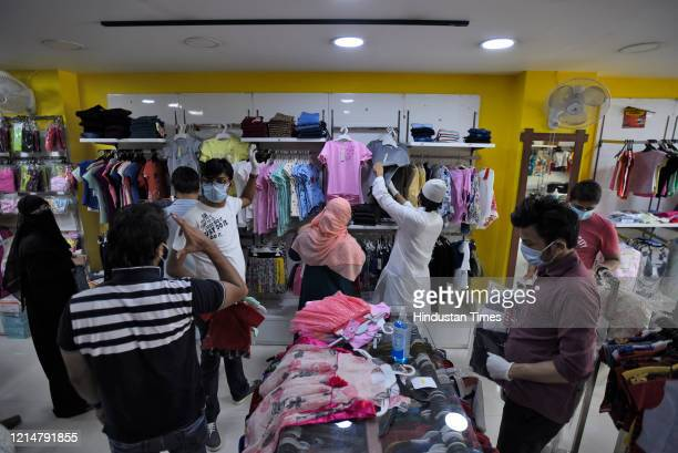 Customers in a clothing store as shops in the Shaheen Bagh market partially open after a gap of five months due to the anti CAA and NRC protests and...