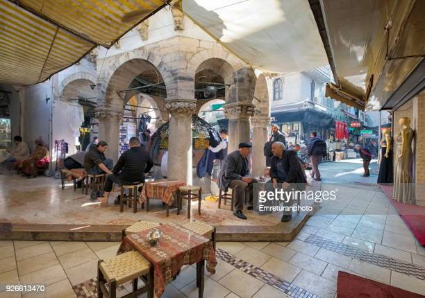 customers in a coffee shop next to a mosque at kemeralti,izmir. - emreturanphoto stock pictures, royalty-free photos & images