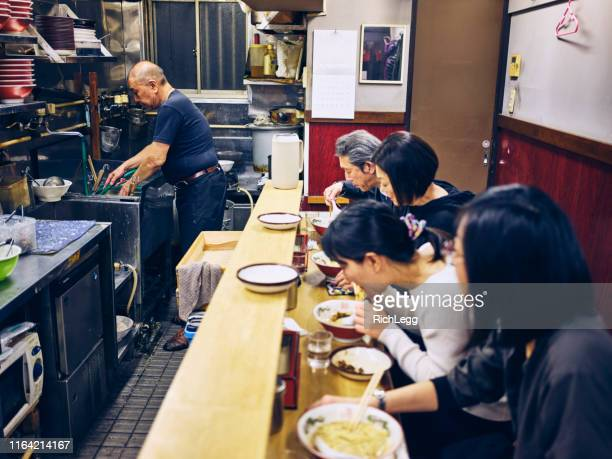 customers in a ramen shop in tokyo japan - ramen noodles stock pictures, royalty-free photos & images