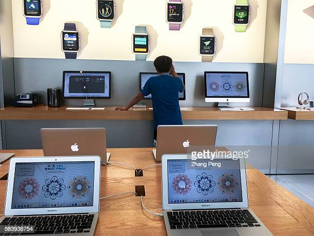 Customers in an Apple shop in Beijing Dawanglu CBD As Chinese smartphone makers offer better products sales in China fell 33% to $88 billion in the...