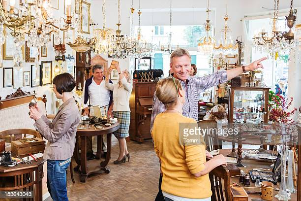 Customers In Antique Store