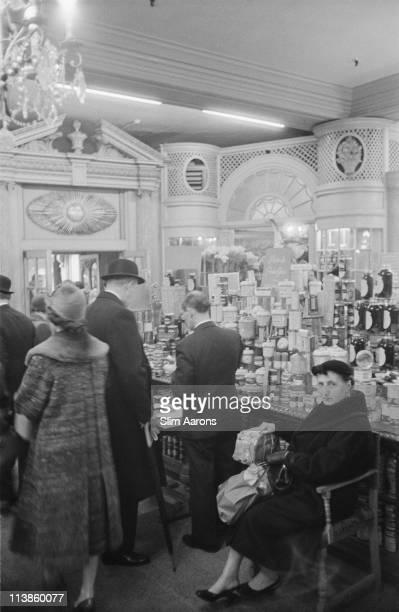 Customers in Fortnum Mason a London emporium 1955