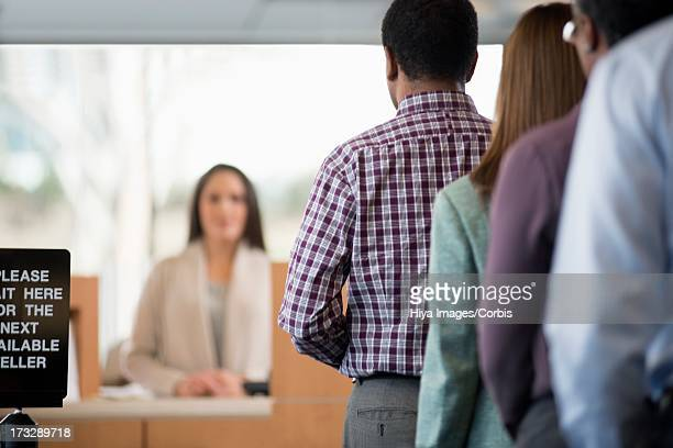Customers in line to bank counter