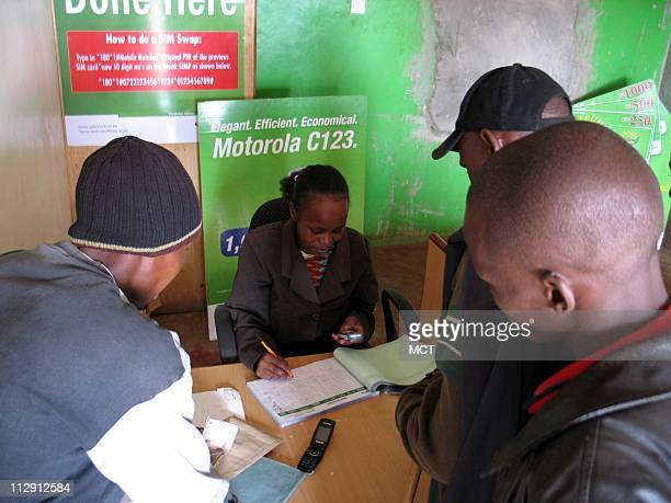 Customers in Ntulele Kenya send money via MPesa a pioneering cell phone money transfer service that has signed up 55 million customers in less than...