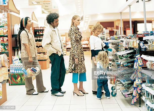 customers in supermarket queue - lining up stock pictures, royalty-free photos & images