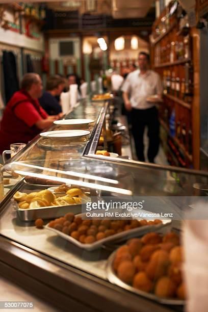 Customers in tapas bar, Barcelona, Spain