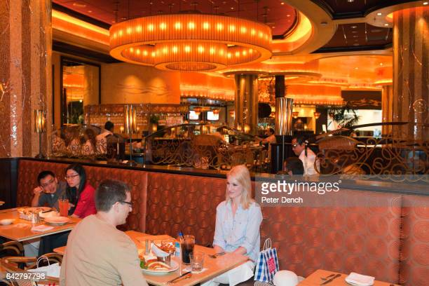 Customers in The Cheescake Factory in the Mall of the Emirates the US chain's largest outlet with 526 seats Diners can look out onto the indoor Ski...