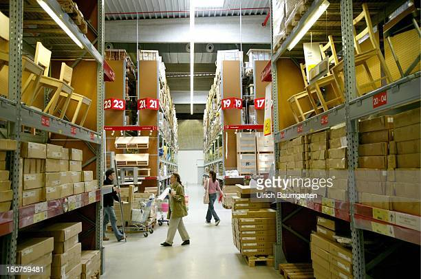 Customers in the warehouse of an IKEA branch