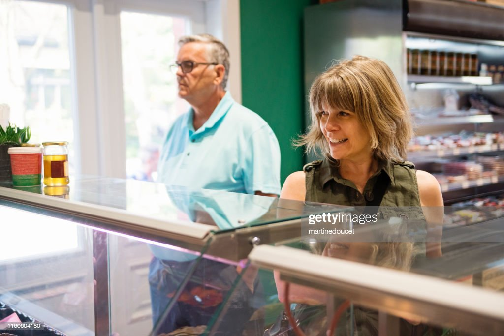 Customers in zero waste oriented grocery and take out food store. : Stock Photo