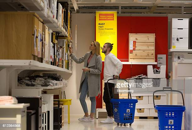 Customers inspect cabinet drawers on display in the Ikea AB retail store in Khimki Russia on Monday Oct 3 2016 Ikea's Russia unit may spend 100...