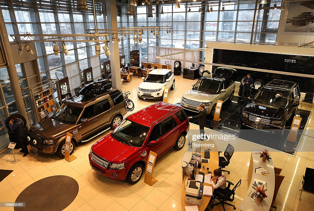Customers inspect Range Rover automobiles on display in an independent auto showroom in Moscow, Russia, on Friday, Dec. 28, 2012. Tata Motors Ltd.'s Jaguar Land Rover luxury unit signed a letter of intent with Saudi Arabia's government to study the feasibility of setting up a factory to build its models locally. Photographer: Andrey Rudakov/Bloomberg via Getty Images