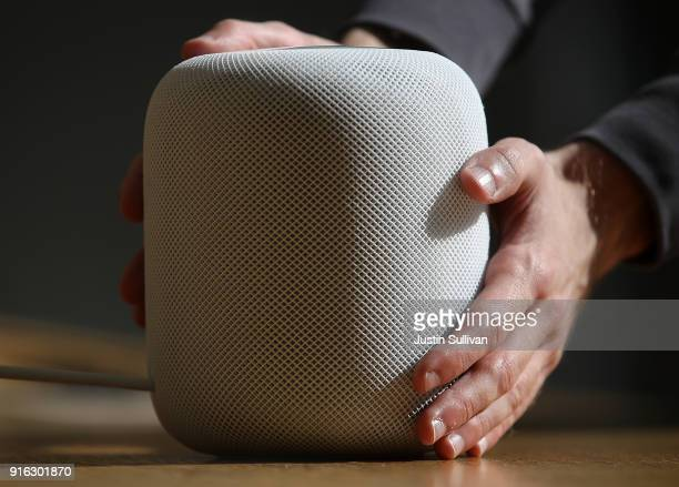 Customers inspect the new Apple HomePod at an Apple Store on February 9 2018 in San Francisco California Apple's new HomePod went on sale today at...