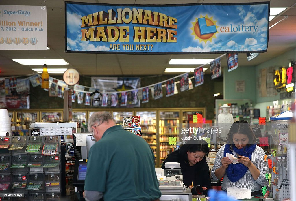 Customers inspect their Powerball tickets at Kavanagh Liquors on January 13, 2016 in San Lorenzo, California. Dozens of people lined up outside of Kavanagh Liquors, a store that has had several multi-million dollar winners, to -purchase Powerball tickets in hopes of winning the estimated record-breaking $1.5 billion dollar jackpot.
