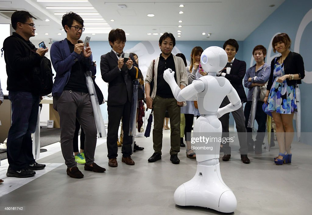 SoftBank Corp.'s Humanoid Robot Pepper Interacts With Customers At A SoftBank Store : News Photo