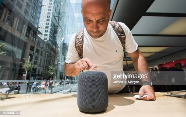 Customers interacting with the new product at the launch of the HomePod at the Apple Store on February 9 2018 in Sydney Australia Apple's latest...