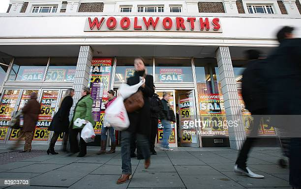 Customers leave a branch of Woolworths in Camden on December 5 2008 in London England Retailers are discounting earlier than usual in the...