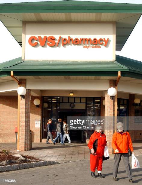 Customers leave a CVS store February 3 2003 in Suffern New York CVS Corp posted a fourth quarter profit February 4 reporting earnings of $2001...