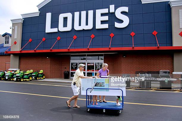 Customers leave a Lowe's store with their purchases in Wake Forest North Carolina US on Saturday Aug 14 2010 Lowe's Cos the secondlargest US home...