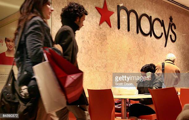 Customers leave a Macy's store along the Magnificent Mile February 2 2009 in Chicago Illinois Today Macy's Inc announced that it will cut nearly 4...