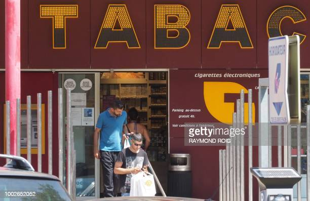 Customers leave a 'tabac' in Perthus a small town on the FrenchSpanish border on July 20 2018 The regional chamber of accounts for Occitanie has...
