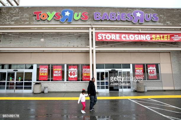 Customers leave a Toys R Us store on March 15 2018 in Emeryville California Toys R Us filed for liquidation in a US Bankruptcy court and plans to...
