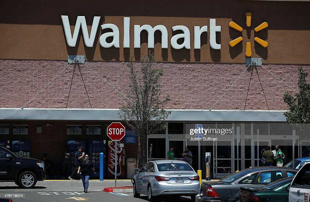 Customers leave a Wal-Mart store on June 11, 2015 in Oakland, California. A federal judge has ruled that Wal-Mart failed to pay the California minimum wage to truck drivers and could have to pay $100 million in back pay.
