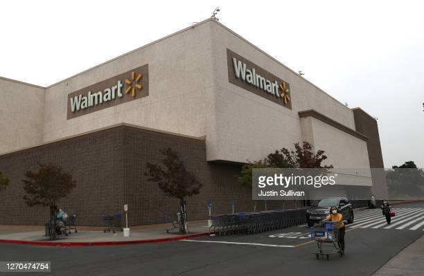 Customers leave a Walmart store on September 03, 2020 in Richmond, California. Walmart has announced plans to launch Walmart Plus delivery service to...