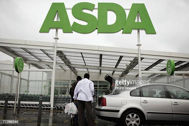 Customers leave an ASDA superstore with their goods on June 26 2006 in London England Thousands of Asda depot workers are due to strike for five days...