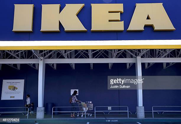 Customers leave an IKEA store on June 26 2014 in Emeryville California Swedish furniture retailer IKEA announced that it plans to raise the minimum...