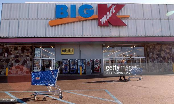 Customers leave Kmart Corps Big K store in Farmington Hills Michigan on 22 January after Kmart filed for bankruptcy protection becoming the largest...