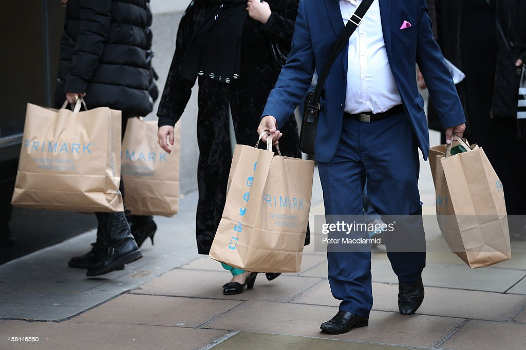 Customers leave Primark's flagship store on Oxford Street with their purchases on November 5, 2014 in London, England. Retail giant Marks and Spencer have shown a continued decline in clothes sales as budget fashion chain Primark has delivered a 16% increase in its sales.