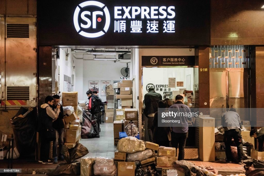 Customers Line Up At An S F Express Store In Hong Kong