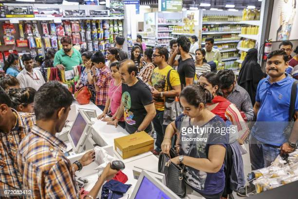 Customers line up at checkout counters inside a Big Bazaar hypermarket operated by Future Retail Ltd in Mumbai India on Sunday April 16 2017 Future...