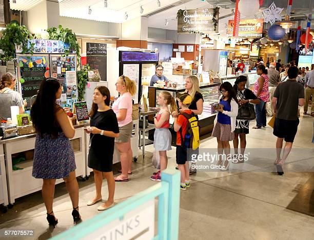 Customers line up at lunch time for drinks and other food items at the Boston Public Market on July 15 2016