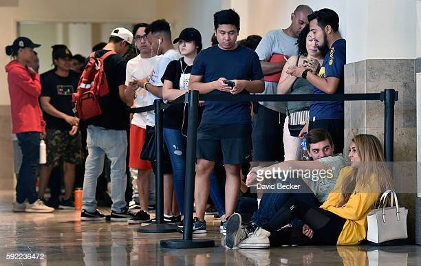 Customers line up before the Kanye West temporary PABLO store opens at the Fashion Show mall on August 19 2016 in Las Vegas Nevada