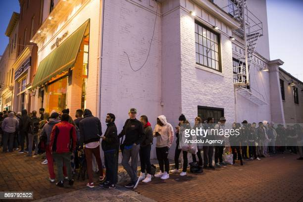 Customers line up hours before opening to be some of the first to get their hands on the new iPhone X at the Georgetown Apple Store in Washington USA...