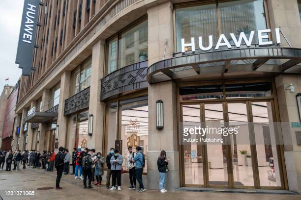 Customers line up in front of Huawei's global flagship store on Nanjing Road as Huawei's Mate X2 goes on sale at 10:08 am on February 25, 2021 in...