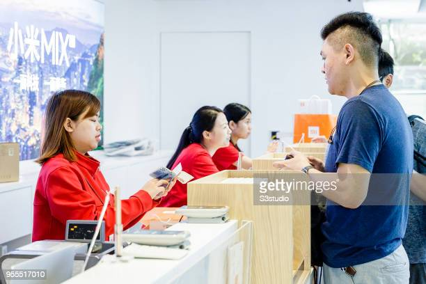 Customers line up inside of the Xiaomi Corp store on Nathan Road in Hong Kong on May 7 2018 in Hong Kong Hong Kong A report by Strategic Analytics...