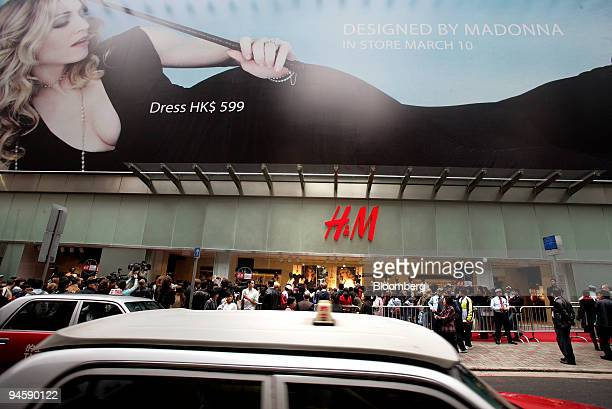 Customers line up outside HM before the doors opened for the first time in Hong Kong China on Saturday March 10 2007 Hennes Mauritz AB Europe's...