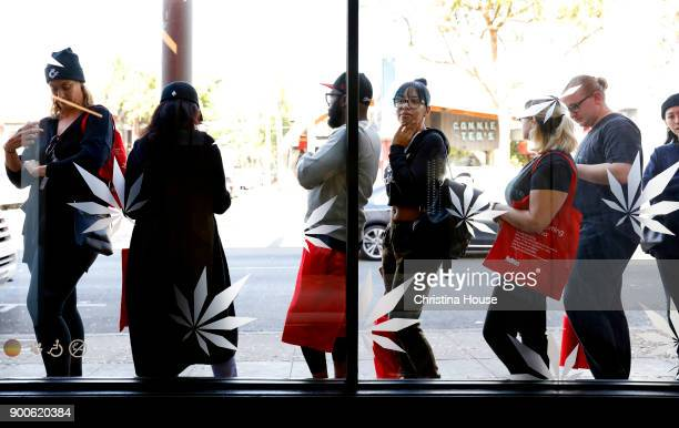 Customers line up outside MedMen on the first day of recreational marijuana sales January 2 2018 in West Hollywood California