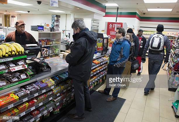 Customers line up to purchase Powerball lottery tickets at a 7Eleven store on February 11 2015 in Chicago Illinois Ticket sales have caused the...