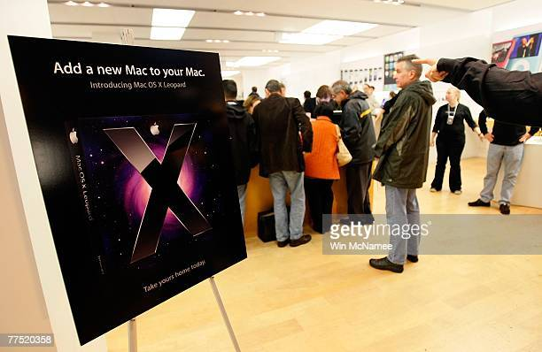 Customers line up to purchase the new Apple computer operating system known as Leopard at an Apple store October 26 2007 in Arlington Virginia...